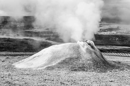 the stinking: Fumarole in the geothermal area Hveravellir, central Iceland. The area around is layered and cracked. Stock Photo