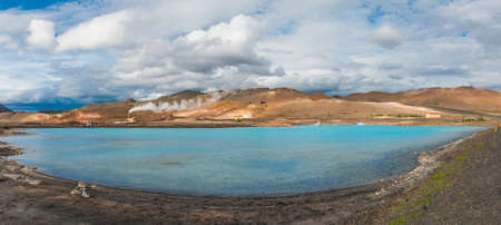 Blue water of the pool silica produced by a nearby geothermal plant. The lake is Located near the Lake Myvatn, Iceland.