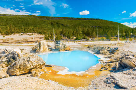 Porkchop geyser with an opaque thermal pool at Norris Geyser Basin. Yellowstone National Park, Wyoming - USA