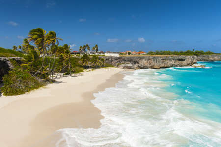 paradise bay: Bottom Bay is one of the most beautiful beaches on the Caribbean island of Barbados. It is a tropical paradise with palms hanging over turquoise sea and a pirate cave