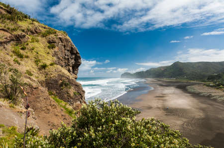 Beautiful Piha beach near Auckland seen from the mighty Lion Rock, New Zealand Stock Photo