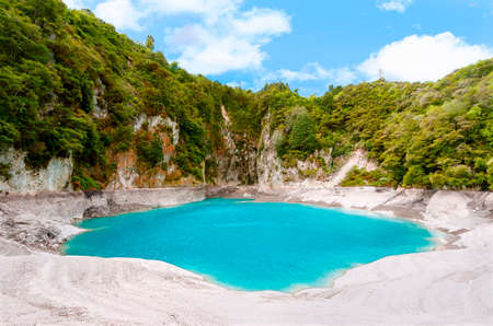 Incredibly blue and highly acidic Inferno Crater Lake at Waimangu geothermal area, New Zealand Stock Photo