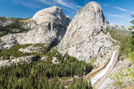 Beautiful Nevada Falls is located on Merced river and under mighty Liberty Dome grantite cap. Yosemite National Park, California, USA Stock Photo