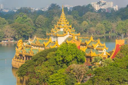 royals: Golden Karaweik palace on Kandawgyi lake looks like an ancient royal barge. Yangon, Myanmar
