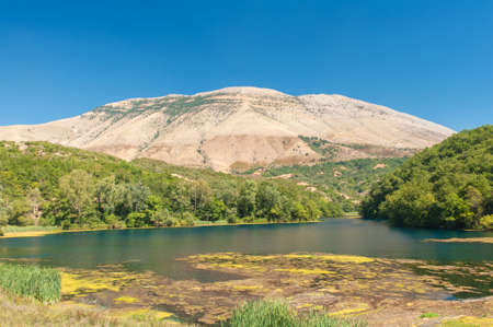 Beautiful lake Syri i Kalter surrounded by mighty mountains. Not far from Sarrande, Southern Albania