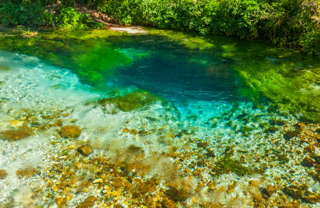very cold: Beautiful turquoise spring Blue Eye (Syri i Kalter) near a town of Muzine, Albania. The spring is very powerful,  cold and deep and is a source of a river Bistrice