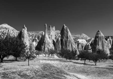 Spectacular teeth-like rock formation and old christian caves near Goreme, Cappadocia, Turkey.  Black and white