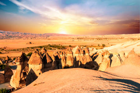 Fairy tale chimney rocks in Pasabg (Monk) Valley at sunset in Cappadocia, Turkey