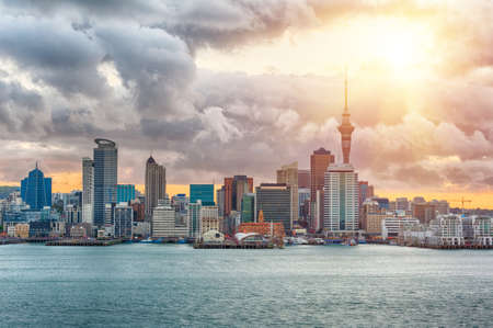 Skyline photo of the biggest city in the New Zealand, Auckland. The photo was taken during the golden sunset across the bay Stock Photo