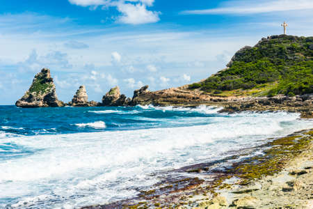 Rocks and hills  of Pointe des Chateaux, the most Eastern point of French island  of Guadeloupein the Caribbean Stock Photo