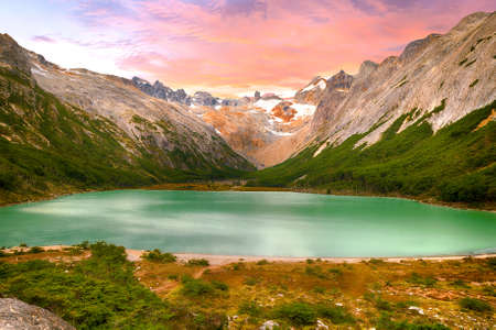 Sunset over Andes mountains and lake Laguna Esmeralda near Ushuaia in Tierra del Fuego, Argentina Stock Photo