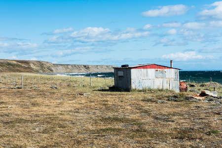 Red fishermans cottage near the coast. Tierra del Fuego, Chile Banco de Imagens