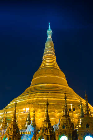 Shwedagon Paya is the most sacred golden buddhist pagoda in Myanmar. Yangon, Myanmar. Evening photo