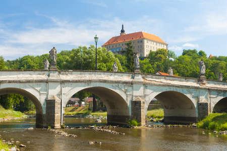 Baroque bridge with statues and Castle in Namest nad Oslavou, Czech Republic
