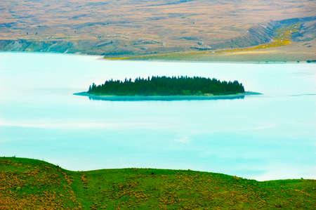 Small Motuariki Island on a lake Tekapo. New Zealand