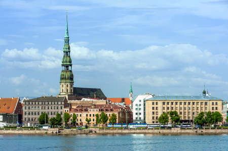 Skyline of Riga seen across the river Daugava. The tallest building on the picture is the St. Peter's Church
