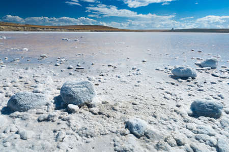 Salt lake with crystal coated stones in Tierra del Fuego in Argentina 写真素材