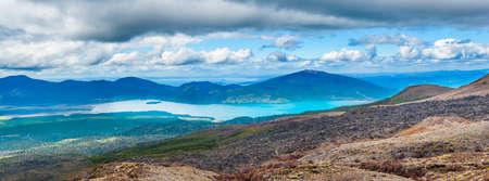 Panoramic photo of Lake Rotoaira seen from volcanic slope of Mt. Tongariro on Tongariro Crossing national park. North Island, New Zealand