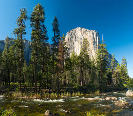 El capitan granite rock seen from the Yosemite Valley across the Merced river, Yosemite National Park, USA