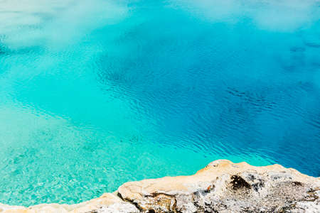 Turquoise blue geothermal pool in Yellowstone National Park, Wyoming - USA