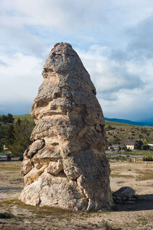 Liberty Cap is an old dormant hot spring in Mammoth Hot Springs area, Yellowstone National Park. Wyoming, USA