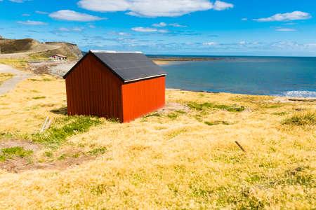 Red fisherman's cottage near the coast in the small village Cameron. Tierra del Fuego, Chile 写真素材