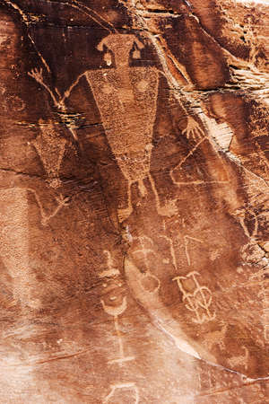 Man rock art (petroglyphs) by ancient Fremont people - native Americans - seen during hiking at Dinosaur National Monument in Utah, USA