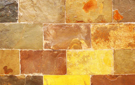 affixed: Sedimentary rock chip affixed to a house built outside the walls --  Stock Photo