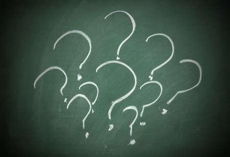 Question marks on a blackboard