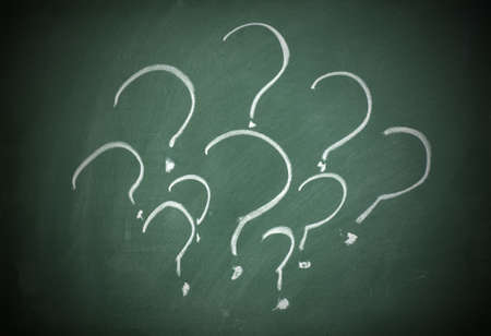 Question marks on a blackboard Stock Photo - 9010366
