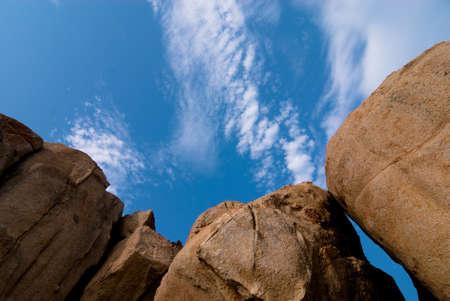 granite park: huge granite boulder on blue sky background