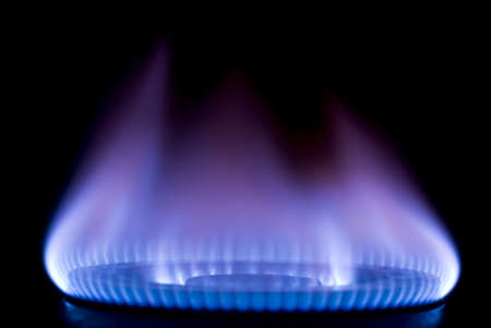 natural gas prices: burning on a gas stove in the kitchen