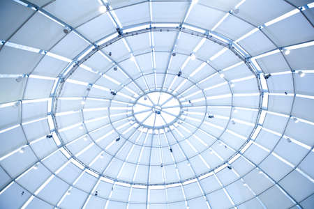 the metal and glass roof of a mall Standard-Bild