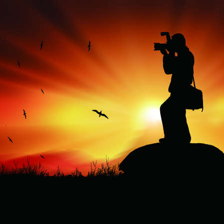 Silhouette of a photographer with a camera photo