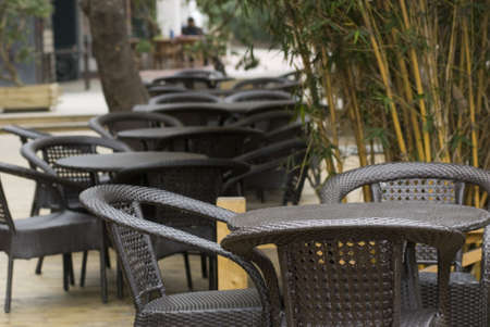 Tables and rattan chairs Stock Photo - 11801788