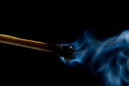 Burning match on black background Stock Photo - 11938474