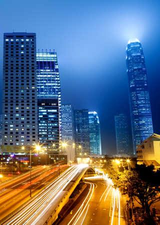 night traffic: moving car with blur light through city at night