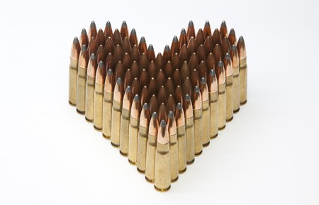 Heart shaped ammo isolated on white Stock Photo