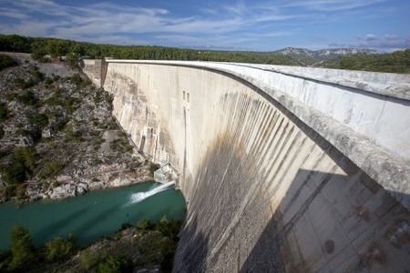 Wide concrete hydroelectric dam in southern France Stock Photo - 7965113