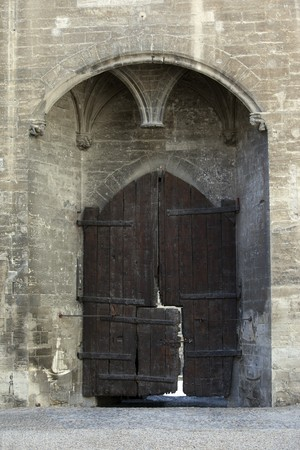 Huge and very old wooden door in a medieval castle