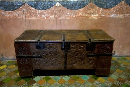 Old medieval carved wooden chest photo
