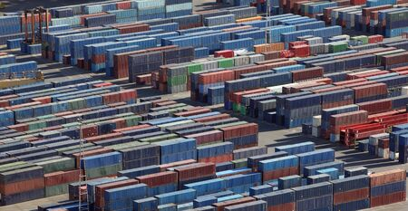 Aerial view of stacked intermodal containers in a port
