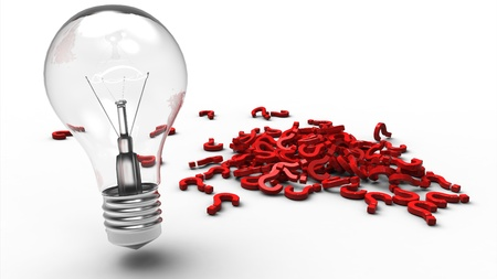 Light bulb next to a pile of red plastic question marks