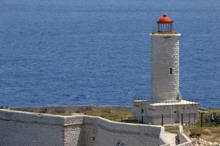 Stone lighthouse in If island near Marseille photo