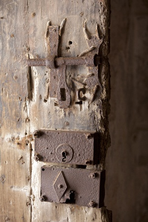 Old rusty wooden door locks and latches photo