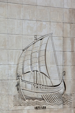 hist: Galley carved on a stone wall of a building