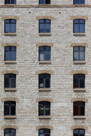 symetry: Facade of an old style stone building showing a symmetric array of window
