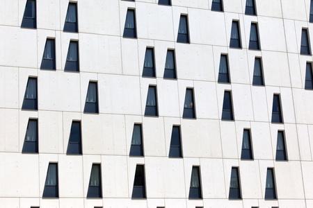 White facade of a modern building with randomly placed windows Stock Photo - 9796839