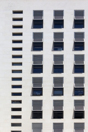 old building facade: Front view of a high white modern building with evenly placed windows Stock Photo