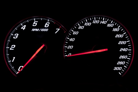 Speedometer and revcounter on black background Stock Photo
